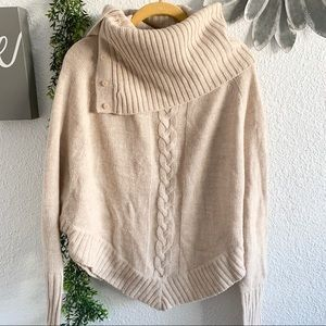 R D Style beige turtleneck poncho with sleeves